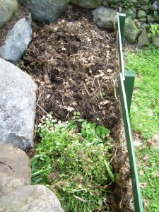 At the bottom is the newer pile and the almost composted pile is at the top finishing up.